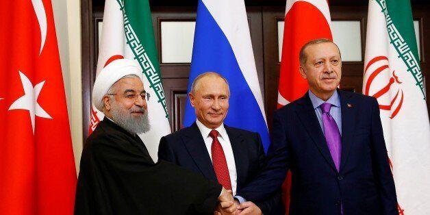 SOCHI, RUSSIA - NOVEMBER 22: Turkish President Recep Tayyip Erdogan (R), Russian President Vladimir Putin...