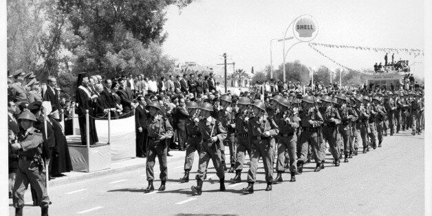 Members of the Greek-Cypriot Army parade past President Makarios during Eoka Day celebrations in Nicosia,Cyrus,...