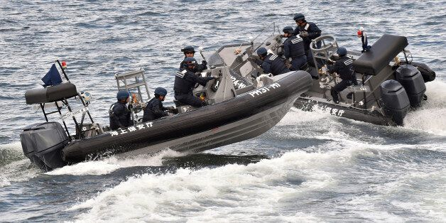 Japan Coast Guard security team display tracking and capture drills by rigid-hulled inflatable boats...