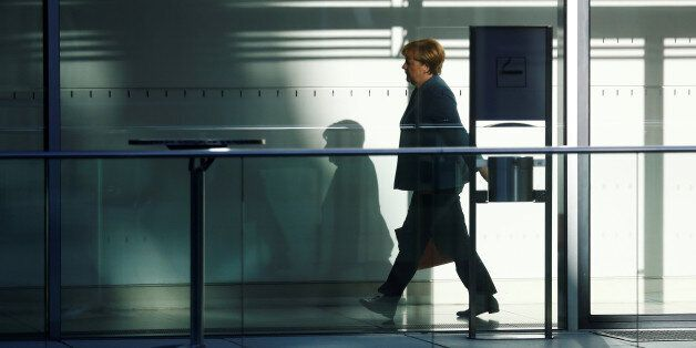 Angela Merkel, leader of the Christian Democratic Union (CDU), walks through the Reichstag building before...