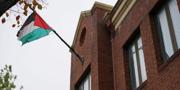 The flag of the Palestine Liberation Organisation is seen above its offices in Washington, DC on November...