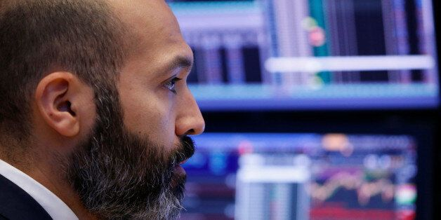 A trader works on the floor of the New York Stock Exchange shortly after the opening bell in New York,...