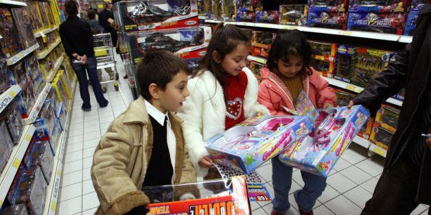 ATHENS, GREECE: Greek children hold their Christmas gifts on sale in central Athens' shopping district...