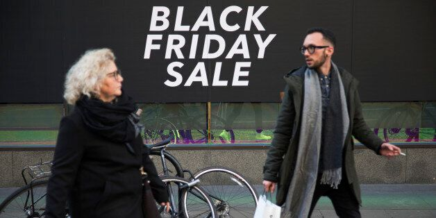 Shoppers on Oxford Street in central London with a sign advertising Black Friday in a shop window on 25th November 2017 in London, England, United Kingdom. This is the busiest shopping district in the capital with Oxford Street being Europe's busiest shopping area. (photo by Mike Kemp/In Pictures via Getty Images)