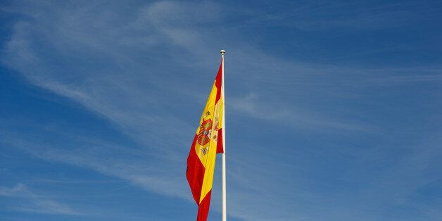 A Spanish national flag hangs from a flagpole in the San Sebastian de los Reyes district of Madrid, Spain,...
