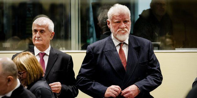 Former Bosnian Croat Defense Minister Bruno Stojic and former Croatian general Slobodan Praljak (R) are...