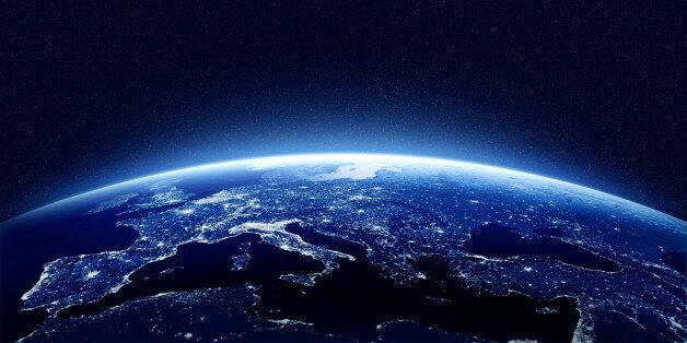 Earth at night as seen from space with blue, glowing atmosphere and space at the top. Perfect for illustrations....