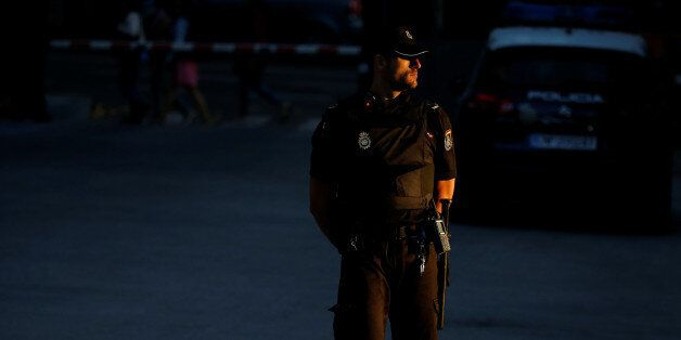 A Spanish national police officer stands guard outiside the High Court in Madrid, Spain, October 16,...