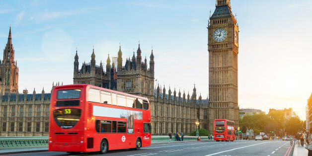 London, United Kingdom - August 20, 2016: Westminster palace and Big Ben and traffic on Westminster bridge...