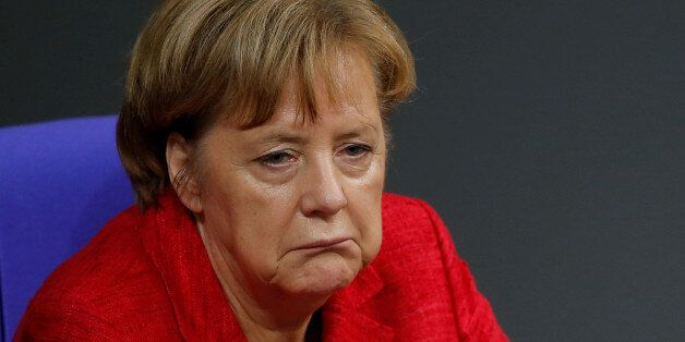 German Chancellor Angela Merkel reacts as she attends a session of the Bundestag in Berlin, Germany,...