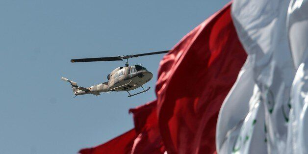 TEHRAN, IRAN - APRIL 18: A military helicopter stages a fly-past during a military parade to mark the...