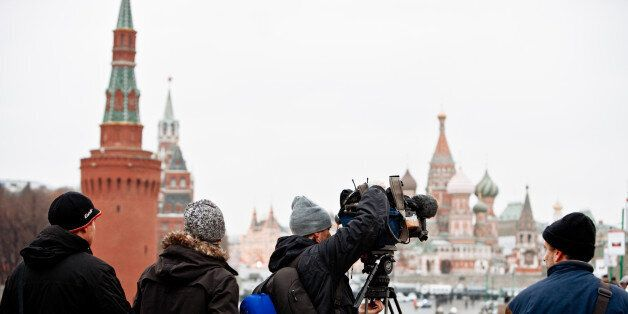 Moscow, Russia - December 10, 2011: TV Reporters installing their camera in front of Red Square on the...