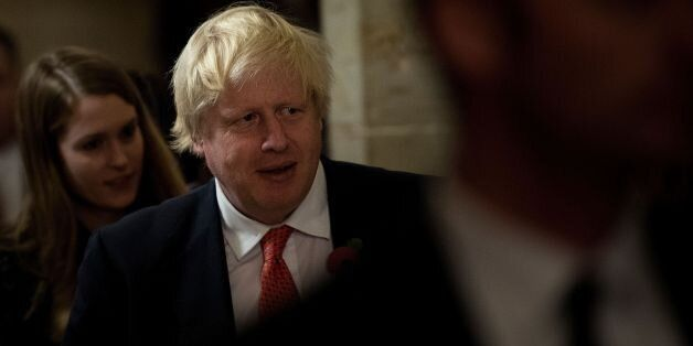 Britain's Foreign Secretary Boris Johnson walks to a meeting with Senate Majority Leader Senator Mitch...