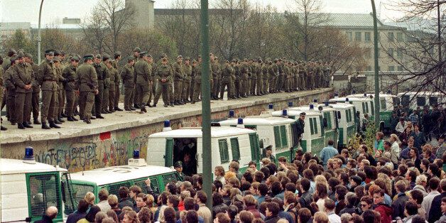 FILE PHOTO 11NOV89 - Hundreds of East Berlin border guards stand atop the Berlin Wall at the Brandeburg...