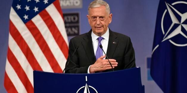 US defence minister James Mattis gestures as he delivers a speech during a press conference at the Nato...