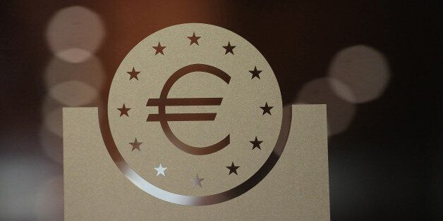 A euro currency symbol sits on a glass panel during the European Central Bank (ECB) Forum On Banking...