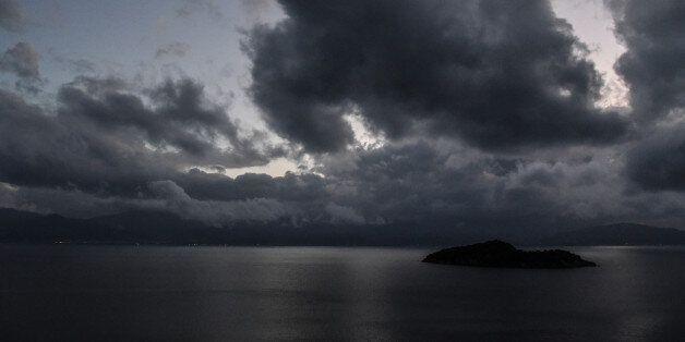 Stormy and rainy weather approaching Prasoudi near Agios Spyridon. The barometric low weatherfront Daedalos...