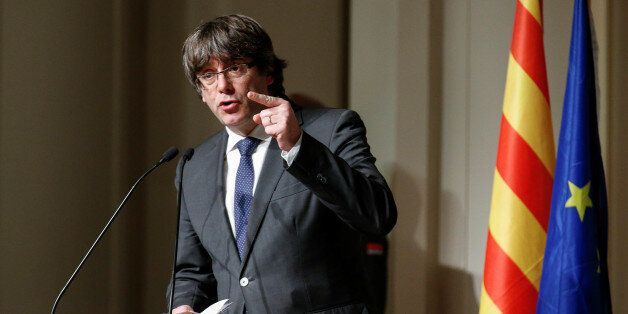 Former Catalan leader Carles Puigdemont gestures while delivering a speech to Catalan mayors in Brussels,...