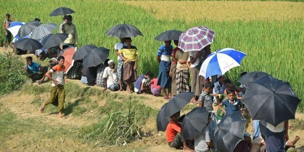 Rohingya refugees wait for relief aid at Balukhali refugee camp in the Bangladeshi district of Ukhia...
