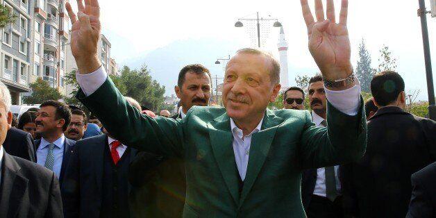 MANISA, TURKEY - NOVEMBER 3 : Turkish President Recep Tayyip Erdogan gestures as he leaves the Manisa...