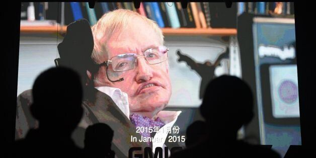 Participants listen to a recorded speech by British physicist Stephen Hawking on artificial intelligence...
