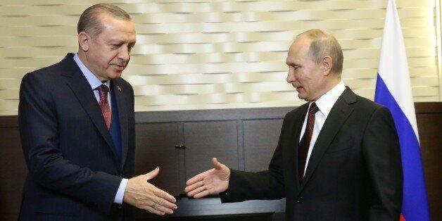SOCHI, RUSSIA - NOVEMBER 13: (RUSSIA OUT) Russian President Vladimir Putin (R) hosts Turkish President...