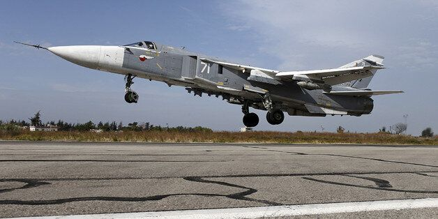 FILES - A Sukhoi Su-24 fighter jet takes off from the Hmeymim air base near Latakia, Syria, in this handout...