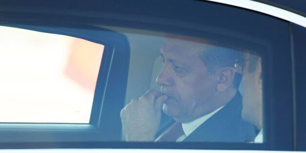 Turkey's President Recep Tayyip Erdogan sits in a car after his arrival at the airport in Hamburg, northern...