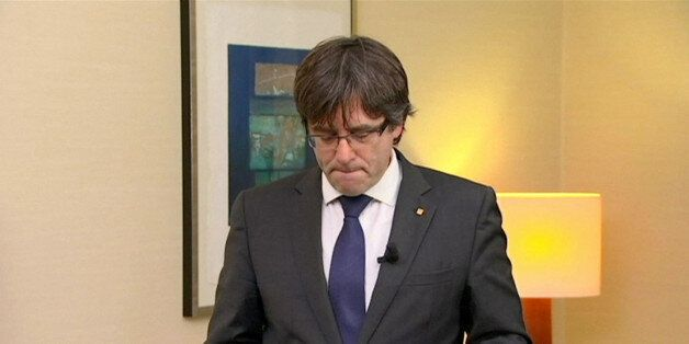 Sacked Catalan President Carles Puigdemont makes a statement in this still image from video calling for...