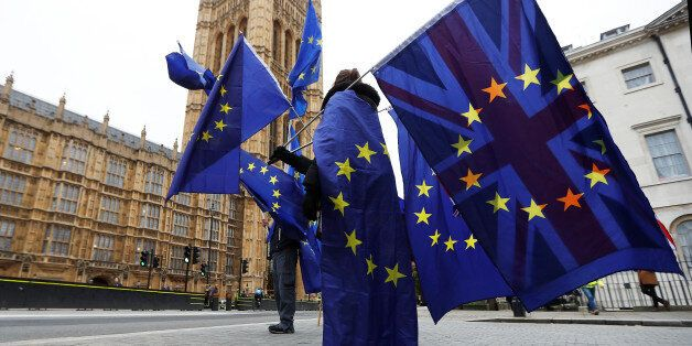 Anti-Brexit protesters wave EU and Union flags outside the Houses of Parliament in London, Britain, November...