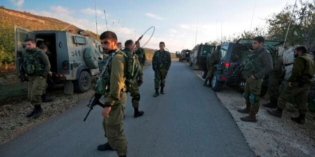 Israeli soldiers close a road near the border with Syria in the Israeli-annexed Golan Heights, after...