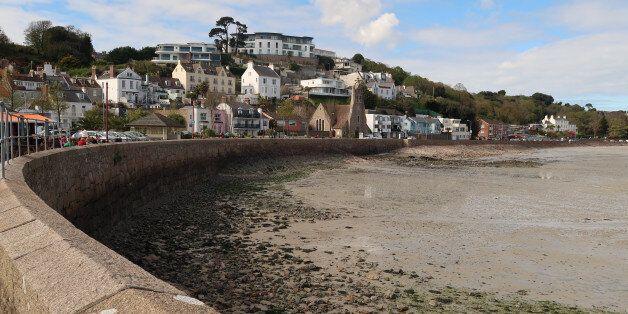 ST HELIER, JERSEY - APRIL 13: Properties overlook the harbour in St Aubin on April 13, 2017 near St Helier,...