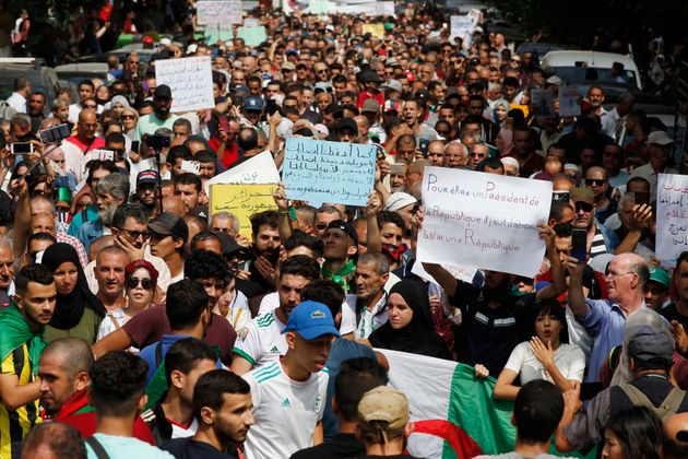 Algerian protesters carrying national flags chanted slogans during the student demonstration in Algiers,...