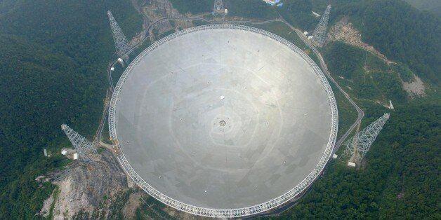 QIANNAN, CHINA - SEPTEMBER 17: Aerial view of a dish-like radio telescope at Pingtang County on September...
