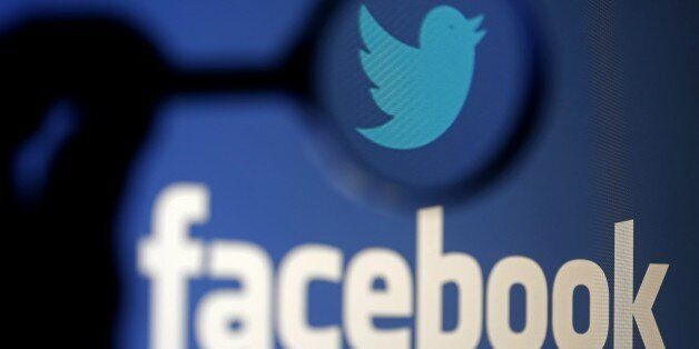 A logo of Twitter is pictured next to the logo of Facebook in this September 23, 2014 illustration photo...