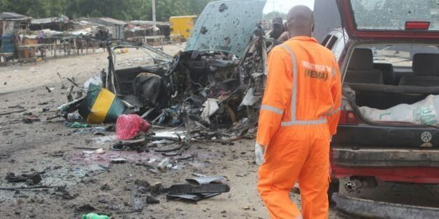 Nema officials at the scene of a bomb blast in Maiduguri, Nigeria on 12 October 2016. Many traders and...