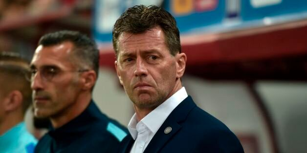 Greece's German coach Michael Skibbe looks on after the World Cup 2018 play-off football match Greece...