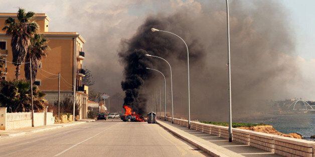 Burning car in the street of sicilian