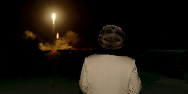 North Korean leader Kim Jong Un watches the ballistic rocket launch drill of the Strategic Force of the...