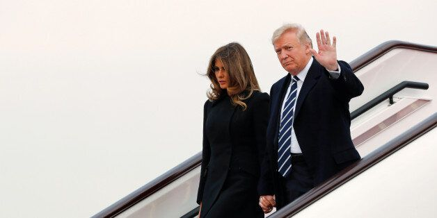 U.S. President Donald Trump and first lady Melania arrive on Air Force One at Beijing, China, November...