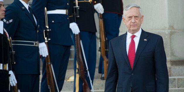 US Secretary of Defense Jim Mattis arrives to greet Georgian Minister of Defense Levan Izoria prior to...