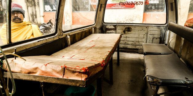 Bhadrapur, Nepal - January 18, 2014: A hospital visitor in eastern Nepal looks through a dilapidated...