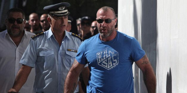 Michos Nikos, lawmaker of the extreme far-right Golden Dawn party, arrives at the police headquarters...