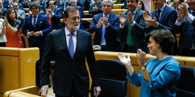 Spain's Prime Minister Mariano Rajoy (L) acknowledges applause during a session of the Upper House of...