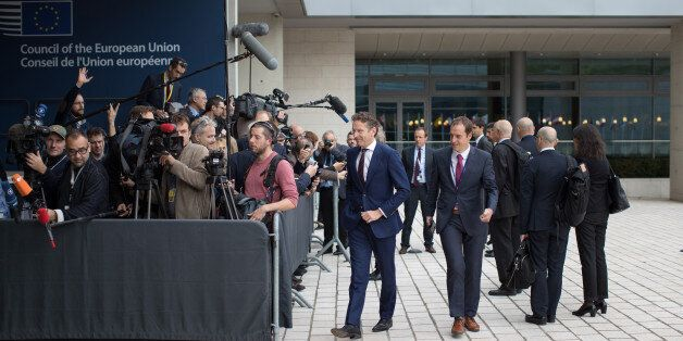 Jeroen Dijsselbloem, Dutch finance minister and head of the group of euro-area finance ministers, center,...