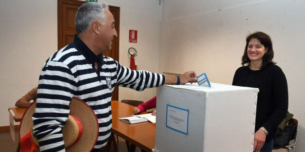 A gondoliere casts his ballot at a polling station during an autonomy referendum in Venice, on October...
