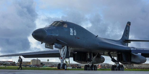 One of two U.S. Air Force B-1B Lancer bombers prepares to take off for a 10-hour mission, to fly in the...