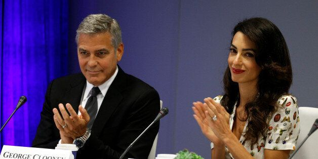 Actor George Clooney and his wife Amal attend a CEO roundtable at the United Nations during the United...