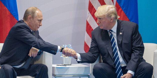 HAMBURG, GERMANY - JULY 07: Russian President Vladimir Putin (left) and President of the United States...