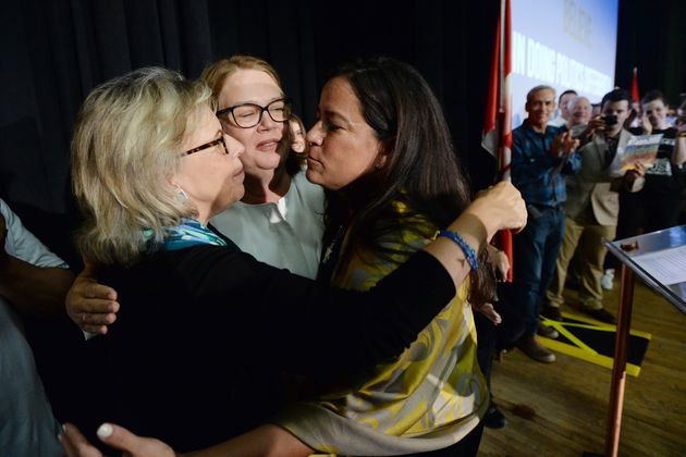 Independent candidates Jody Wilson-Raybould and Jane Philpott and Green Party Leader Elizabeth May hug...